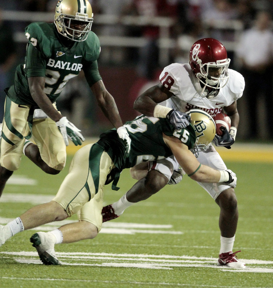 Photo - Oklahoma's Kameel Jackson (18) runs during the college football game between the University of Oklahoma Sooners (OU) and the Baylor Bears (BU) at Floyd Casey Stadium on Saturday, Nov. 19, 2011, in Waco, Texas.   Photo by Steve Sisney, The Oklahoman ORG XMIT: KOD