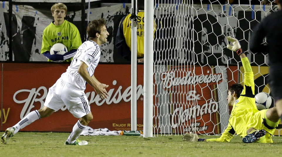 Photo -   Los Angeles Galaxy's Mike Magee celebrates his goal past Michael Gspurning during the second half of an MLS Western Conference finals soccer game in Carson, Calif., Sunday, Nov. 11, 2012. The Galaxy won 3-0. (AP Photo/Chris Carlson)