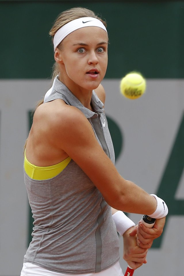 Photo - Slovakia's Anna Schmiedlova returns the ball to China's Zheng Jie during the first round match of  the French Open tennis tournament at the Roland Garros stadium, in Paris, France, Sunday, May 25, 2014. (AP Photo/Michel Euler)