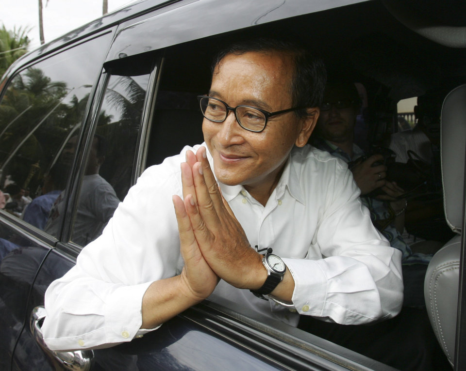 Photo - FILE - IN this July 27, 2008 file photo, Sam Rainsy, leader of Sam Rainsy Party greets to his supporter after casting his vote at a polling station in Kampong Cham province, north of  Phnom Penh, Cambodia. Thousands of cheering supporters greeted Cambodian opposition leader Sam Rainsy as he returned from self-imposed exile Friday, July 19, 2013 to spearhead his party's election campaign against well-entrenched Prime Minister Hun Sen.(AP Photo/Sakchai Lalit, File)