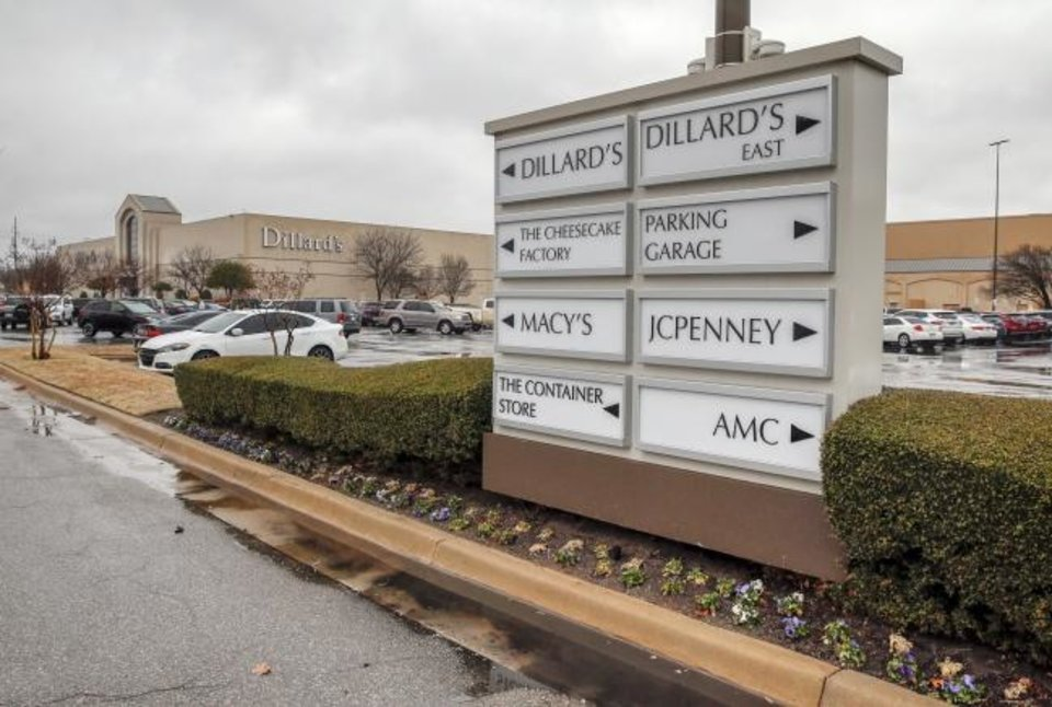 Photo -  The sign shows the direction for stores at Penn Square Mall's entrance off of Northwest Expressway. [Nate Billings/The Oklahoman]