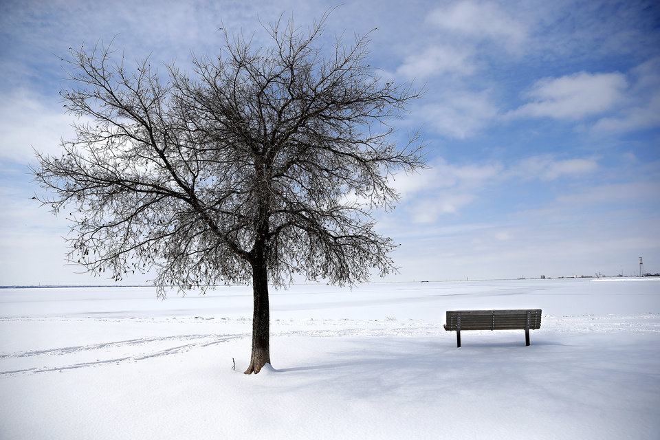 Photo - Lake Hefner is pictured after a snow storm  in Oklahoma City, Wednesday, Feb. 17, 2021. [Sarah Phipps/The Oklahoman]