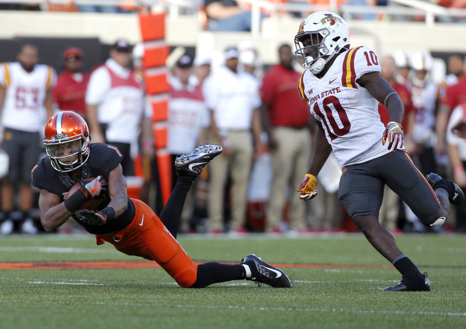 Photo - Oklahoma State's Jalen McCleskey (1) makes a catch in front of Iowa State's Brian Peavy (10) in the fourth quarter during a college football game between the Oklahoma State University Cowboys (OSU) and the Iowa State University at Boone Pickens Stadium in Stillwater, Okla., Saturday, Oct. 8, 2016. Photo by Sarah Phipps, The Oklahoman