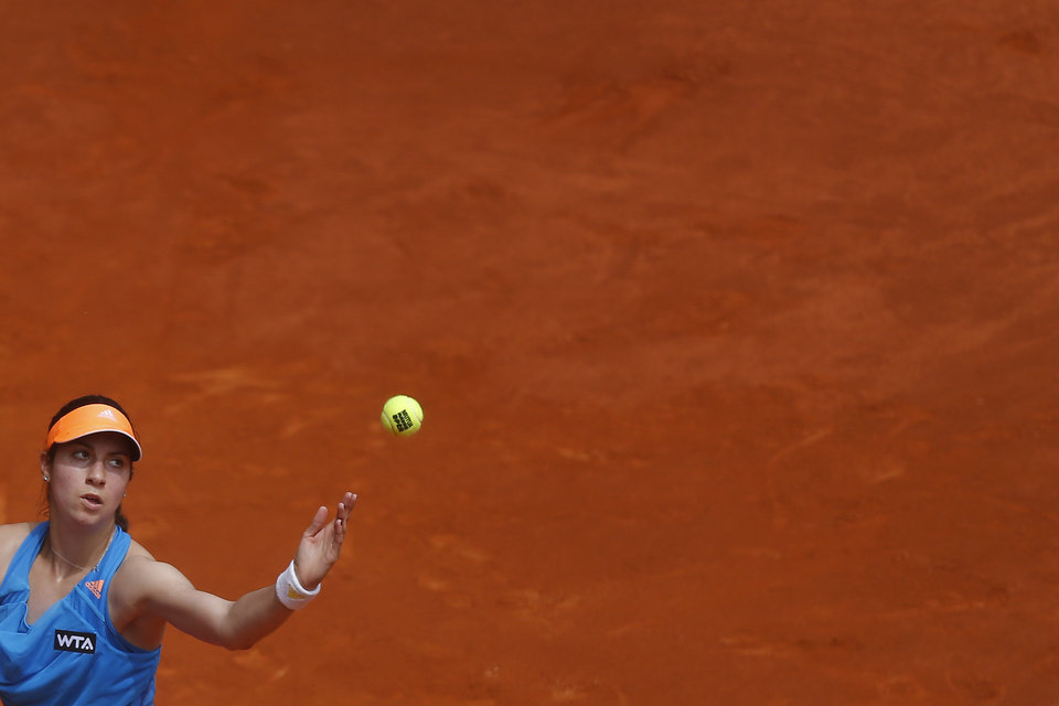 Photo - Christina McHale from US serves during a Madrid Open tennis tournament match against Maria Sharapova from Russia, in Madrid, Spain, Tuesday, May 6, 2014. (AP Photo/Andres Kudacki)
