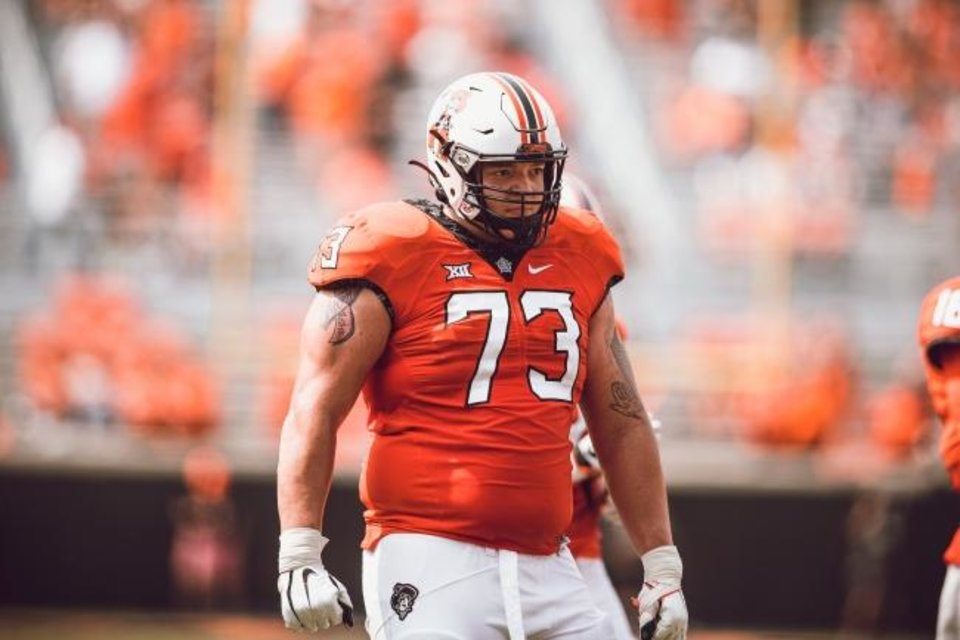 Photo -  Oklahoma State offensive lineman Teven Jenkins is emerging as a potential early-round pick in the NFL Draft. [T.C. Brewster/OSU Athletics]