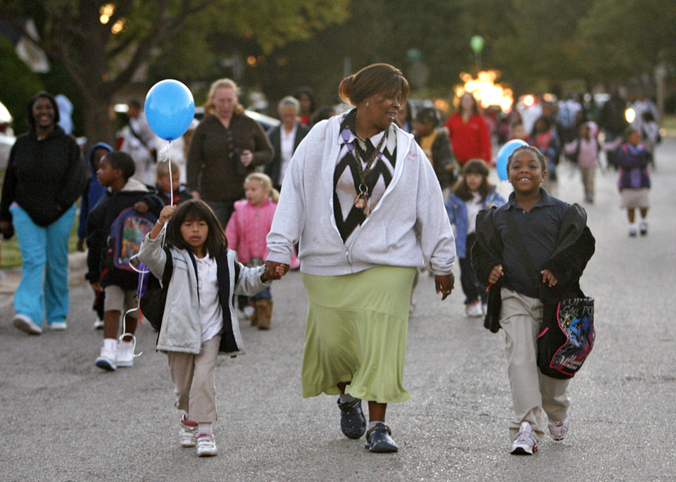 Photo - Selena Antinio, Barbara Glover and Nyiesha Galloway, from left, of Western Village Academy participate in the International Walk to School Day on Wednesday, Oct. 8, 2008, in Oklahoma City, Okla.  CHRIS LANDSBERGER, THE OKLAHOMAN  ORG XMIT: KOD