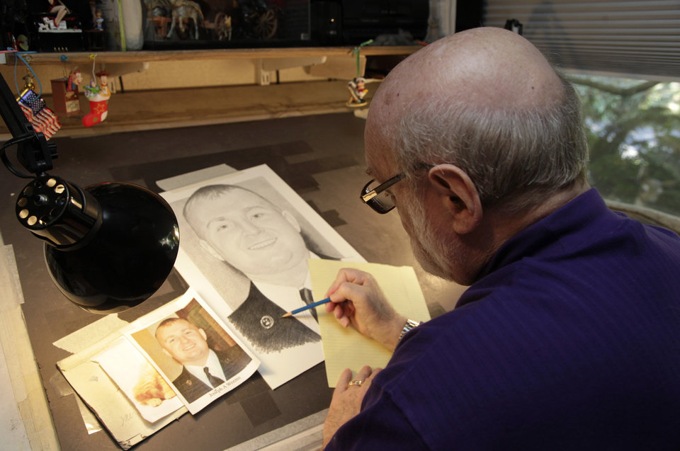 Artist Michael Reagan works on a portrait of Joseph A. Weems, who died after being after being hit by a train while riding his bicycle near the Ramstein Air Base in Germany as he served in the U.S. Air Force, Thursday, Oct. 4, 2012 at his home in Edmonds, Wash. Since starting the Fallen Heros Project in 2004, Reagan has drawn more than 3,000 portraits and given them free-of-charge to families of fallen soldiers. (AP Photo/Ted S. Warren)