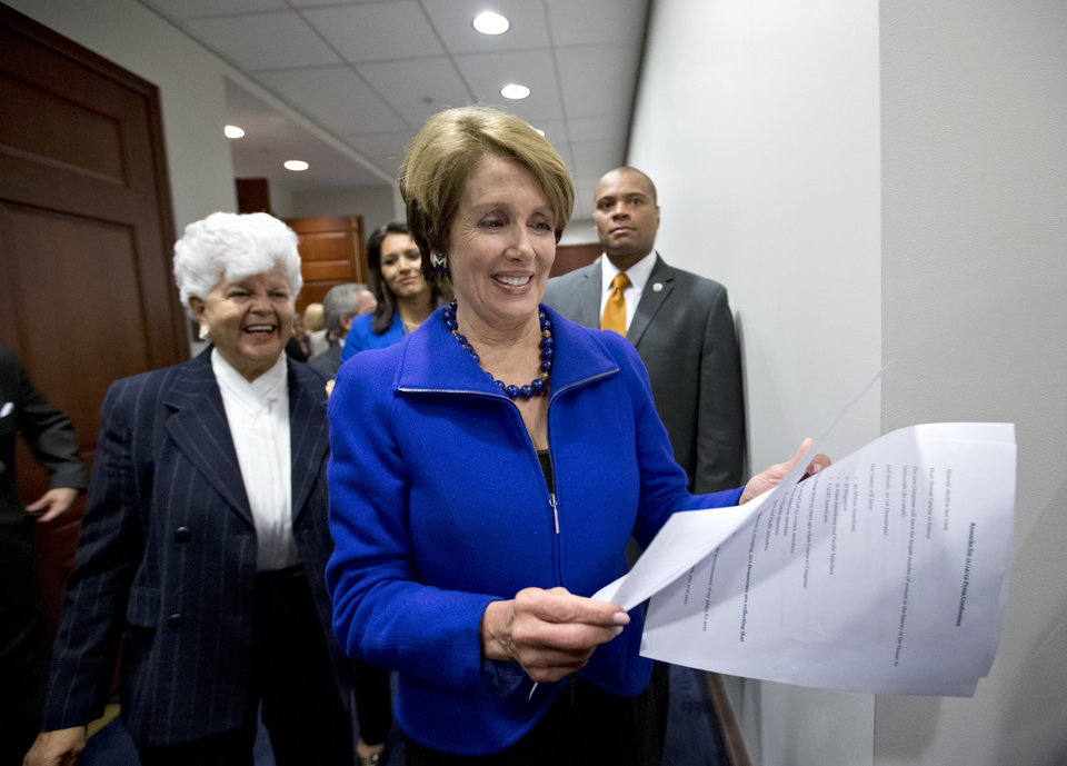 Photo -   House Minority Leader Nancy Pelosi of Calif., followed by Rep. Grace Napolitano, D-Calif., and others, emerges from a closed caucus meeting on Capitol Hill in Washington, Wednesday, Nov. 14, 2012. to announce that she wants to remain as the top Democrat in the House of Representatives. (AP Photo/J. Scott Applewhite)