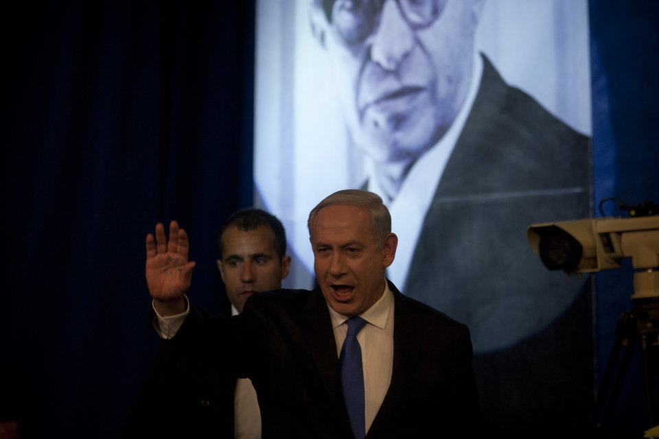 Photo -   Israel's Prime Minister Benjamin Netanyahu arrives to delivers a speech to his Likud party members during the party convention in Tel Aviv, Israel, Sunday, May 6, 2012. Prime Minister Benjamin Netanyahu is expected to announce Sunday night that he'll dissolve parliament to hold early elections, a move designed to fend off domestic critics and perhaps put him in a stronger position to act against Iran.(AP Photo/Ariel Schalit)