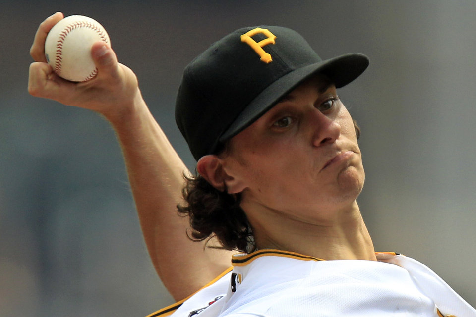 Photo -   Pittsburgh Pirates pitcher Jeff Locke (49)delivers during the second inning against the Houston Astros in a baseball game in Pittsburgh Monday, Sept. 3, 2012. (AP Photo/Gene J. Puskar)
