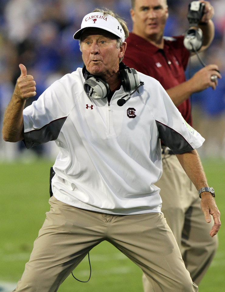 South Carolina coach Steve Spurrier gestures to an official during the first quarter of an NCAA college football game against Kentucky at Commonwealth Stadium in Lexington, Ky., Saturday, Sept. 29, 2012. (AP Photo/James Crisp)