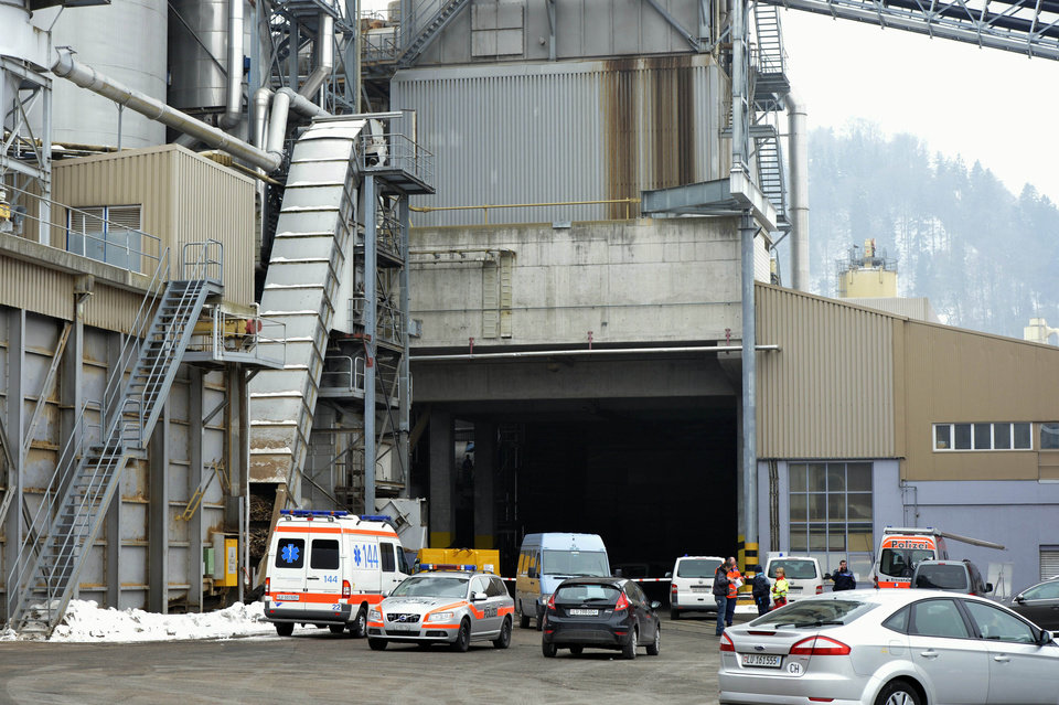Police stand in front of a wood-processing company in Menznau, central Switzerland, Wednesday, Feb. 27, 2013, where several people were killed in a shooting. Police in Lucerne canton (state) said in a statement that the shooting occurred shortly after 9 a.m. at the premises of Kronospan, a company in the small town west of Lucerne. They said there were �several dead and several seriously injured people� and that rescue services were deployed and the scene sealed off. (AP Photo/Keystone, Urs Flueeler)