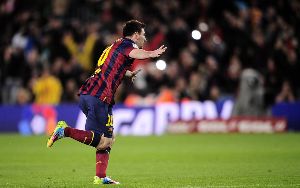 Photo - FC Barcelona's Lionel Messi, from Argentina, reacts after scoring against Almeria during a Spanish La Liga soccer match at the Camp Nou stadium in Barcelona, Spain, Sunday, March 2, 2014. (AP Photo/Manu Fernandez)