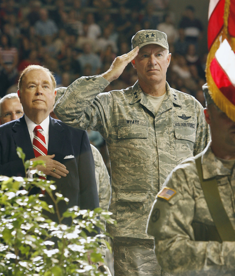 Photo - NATIONAL GUARD DEPLOYMENT, DEPLOYED, DEPLOY, IRAQ WAR, FAREWELL CEREMONY, OU, MAJ. GEN. HARRY WYATT III, HARRY WYATT III: University of Oklahoma President David Boren and Major General Harry M. Wyatt III watch the retiring of the colors at the close of the 45th Infantry Brigade combat team deployment ceremony in the Lloyd Noble Center on Thursday, Oct. 18, 2007, in Norman, Okla.  By STEVE SISNEY, The Oklahoman  ORG XMIT: KOD