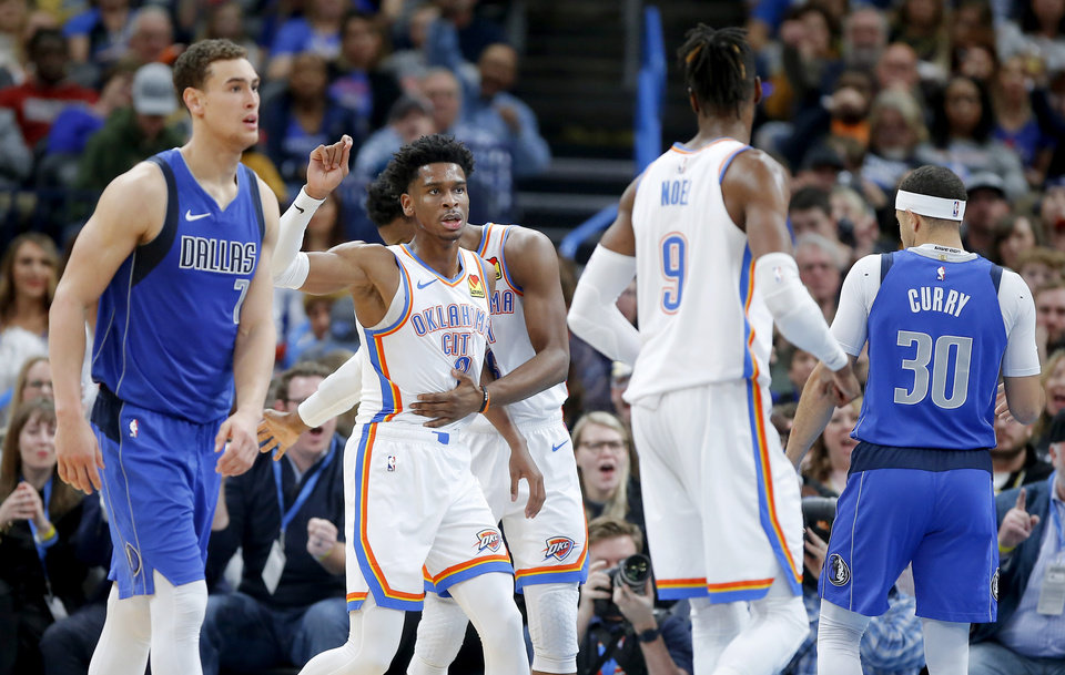 Photo - Oklahoma City's Shai Gilgeous-Alexander (2) gestures after making a basket and getting fouled during an NBA basketball game between the Oklahoma City Thunder and the Dallas Mavericks at Chesapeake Energy Arena in Oklahoma City, Tuesday, Dec. 31, 2019. Oklahoma City won 106-101. [Bryan Terry/The Oklahoman]
