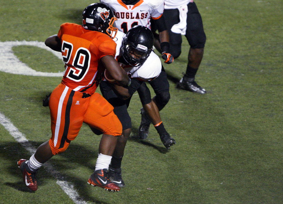 Booker T. Washington running back Hollis Birmingham (29) makes a positive gain during the Douglass-Booker T. Washington season opener, on Friday, Aug. 31, 2012. CORY YOUNG/Tulsa World