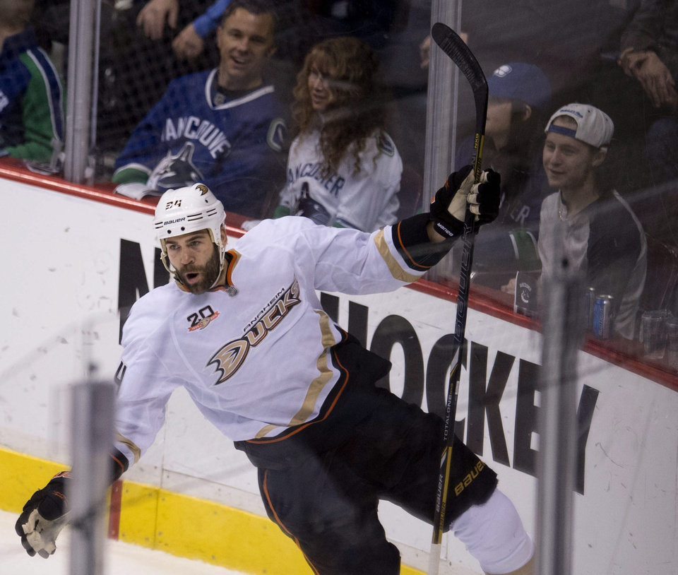 Photo - Anaheim Ducks right wing Daniel Winnik (34) celebrates his goal past Vancouver Canucks goalie Eddie Lack (31) during the first period of NHL action in Vancouver, British Columbia, on Monday, April 7, 2014. (AP Photo/The Canadian Press, Jonathan Hayward)