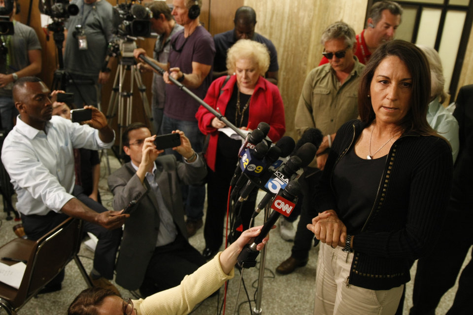 Photo - Ellen Sohus sister of murder victim John Sohus talks during a news conference after a jury found Christian Karl Gerhartsreiter guilty of first-degree murder in the 1985 San Marino killing on Wednesday, April 10, 2013 in  Los Angeles. The verdict was reached Wednesday after the jury deliberated about a day.  Testimony in the cold-case trial of Gerhartsreiter focused on the discovery of the bones of John Sohus long after he and his wife disappeared from his mother's home in San Marino, a wealthy Los Angeles suburb.  The defendant, a German immigrant with delusions of grandeur, rented a cottage at the Sohus home in 1985 then disappeared about the same time as Sohus and his wife Linda who was never found.  (AP Photo/Los Angeles Times, Al Seib)  NO FORNS; NO SALES; MAGS OUT; ORANGE COUNTY REGISTER OUT; LOS ANGELES DAILY NEWS OUT; VENTURA COUNTY STAR OUT; INLAND VALLEY DAILY BULLETIN OUT; MANDATORY CREDIT, TV OUT