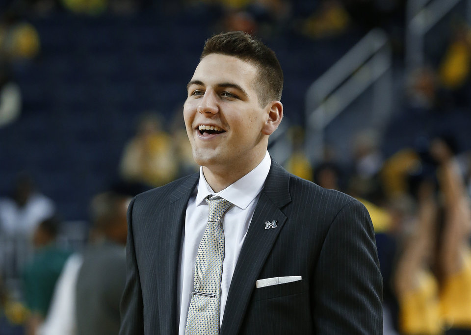 Photo - Michigan Wolverines forward Mitch McGary watches warmups against Wayne State before an exhibition NCAA basketball game in Ann Arbor, Mich., Monday, Nov. 4, 2013. (AP Photo/Paul Sancya)