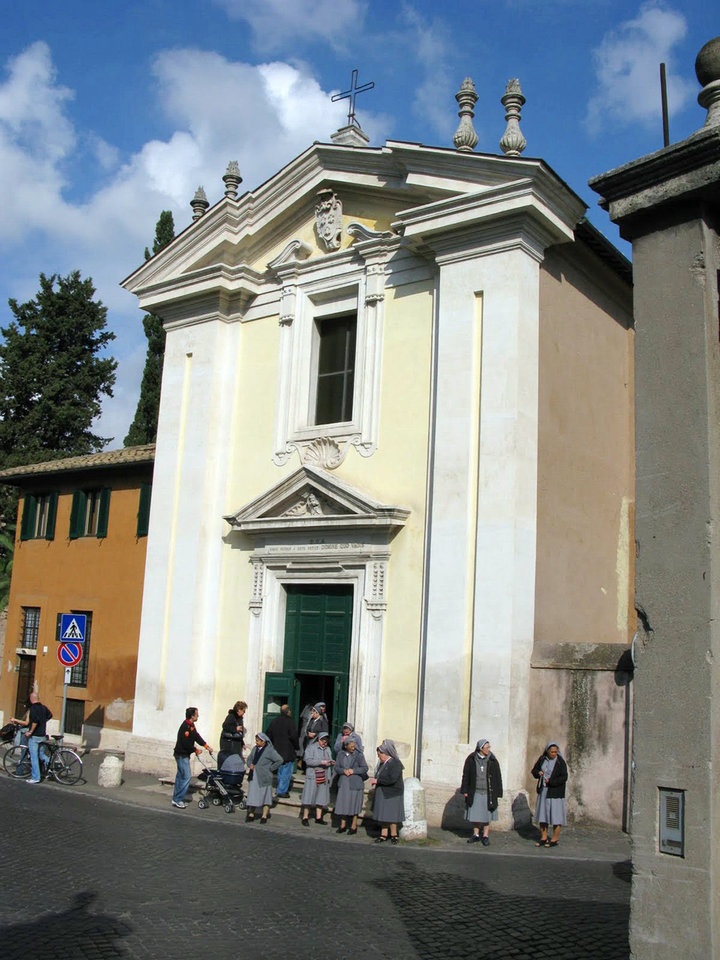 Photo - Worshippers gather outside the Domine Quo Vadis Church along Rome's Appian Way, where St. Peter purportedly had a vision of Jesus. Photo by Ben Cameron