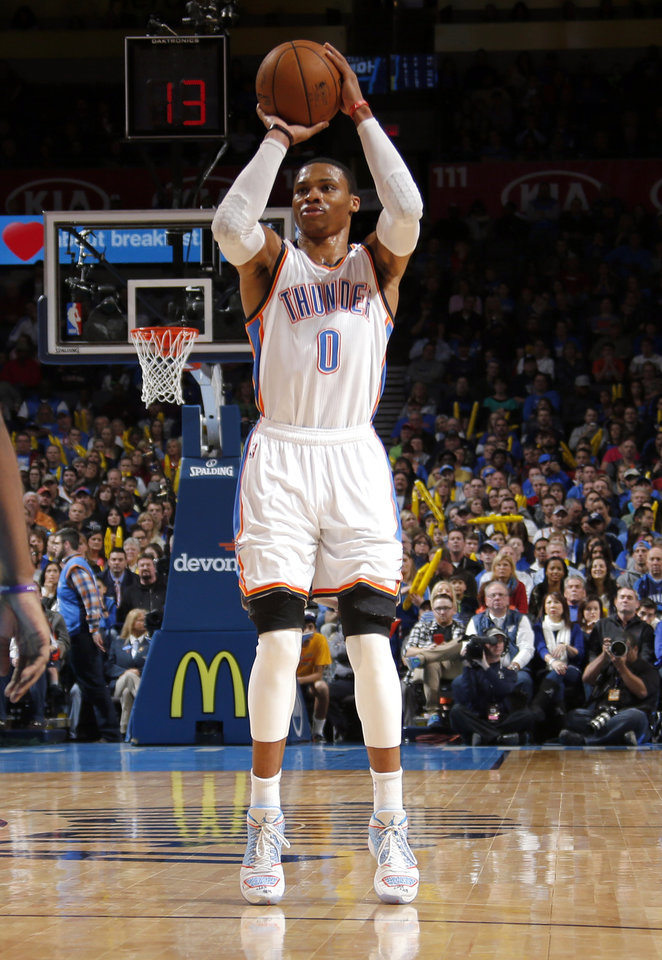 Photo - Russell Westbrook (0) shoots a three-point shot during the NBA basketball game between the Oklahoma City Thunder and the Charlotte Hornets at the Chesapeake Energy Arena in Oklahoma City, Friday, Dec. 26, 2014. Photo by Sarah Phipps, The Oklahoman