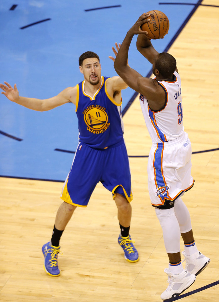 Photo - Oklahoma City's Serge Ibaka (9) shoots over Golden State 's Klay Thompson (11) during Game 3 of the Western Conference finals in the NBA playoffs between the Oklahoma City Thunder and the Golden State Warriors at Chesapeake Energy Arena in Oklahoma City, Sunday, May 22, 2016. Photo by Sarah Phipps, The Oklahoman