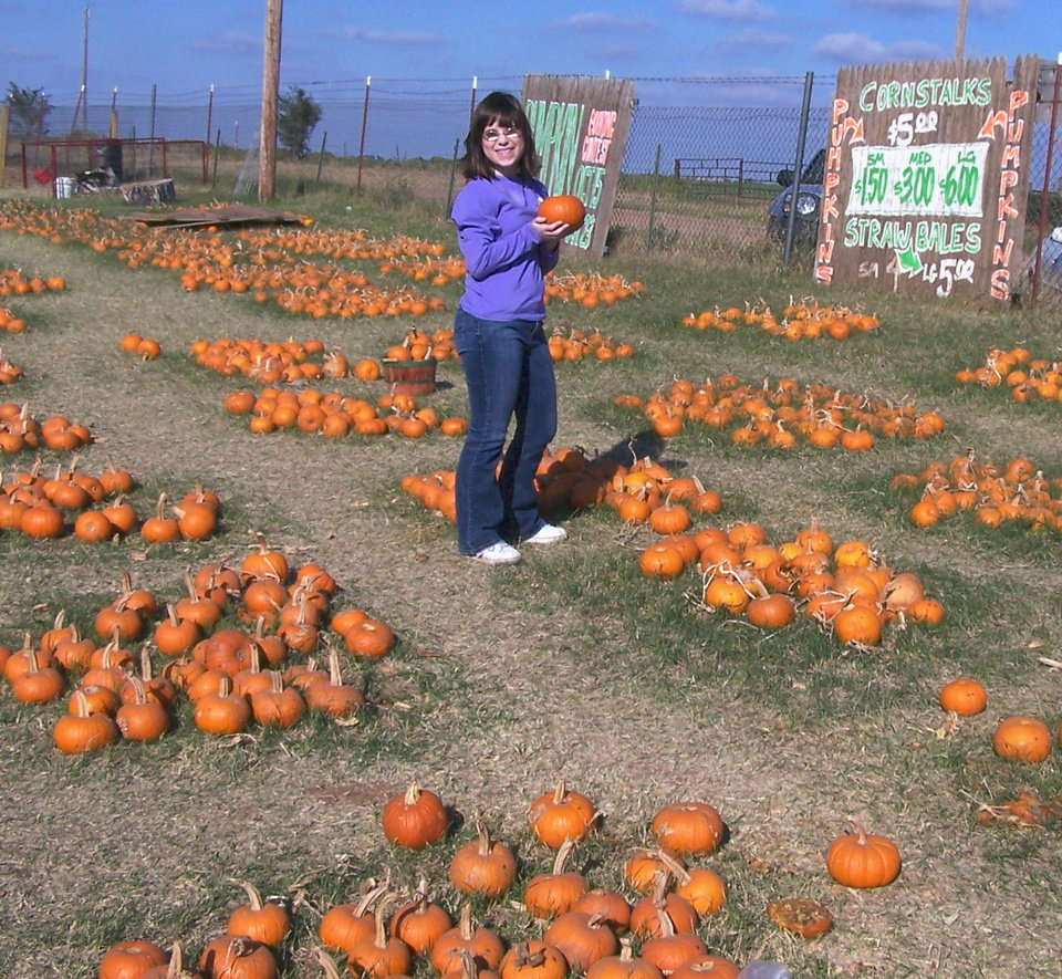 Emily Tennison chooses a pumpkin at Chester's Party Barn near Piedmont.<br/><b>Community Photo By:</b> Cindi Tennison<br/><b>Submitted By:</b> Cindi , Bethany