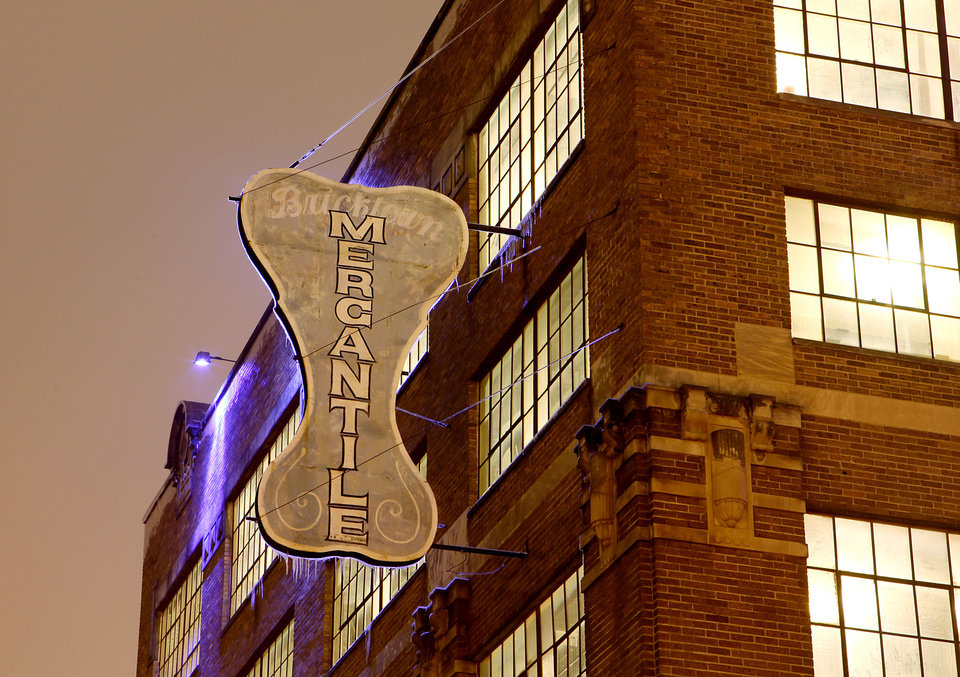 Photo - BUILDING EXTERIOR: The Bricktown Mercantile/Mideke Building in downtown Oklahoma City. The first floor was home to the Bricktown Mercantile and Uncommon Grounds in the 1990s, CityWalk the past dozen years, and more recently, Coco Flow. The top floors have been empty for more than 25 years.   John Clanton - The Oklahoman
