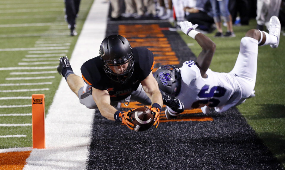 Photo - Oklahoma State's David Glidden (13) scores during the second half of the college football game between the Oklahoma State Cowboys (OSU) and the Central Arkansas Bears at Boone Pickens Stadium in Stillwater, Okla., Saturday, Sept. 12, 2015. Photo by Steve Sisney, The Oklahoman