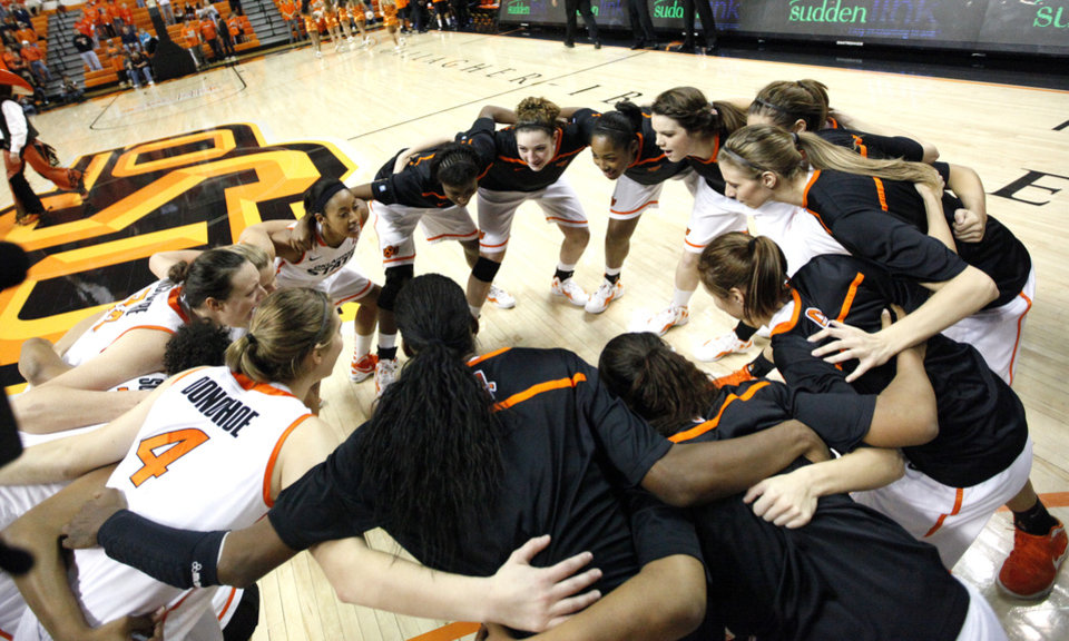Photo - Oklahoma State huddles before the women's college game between Oklahoma State University and Coppin State at Gallagher-Iba Arena in Stillwater, Okla.,  Saturday, Nov. 26, 2011.  Photo by Sarah Phipps, The Oklahoman