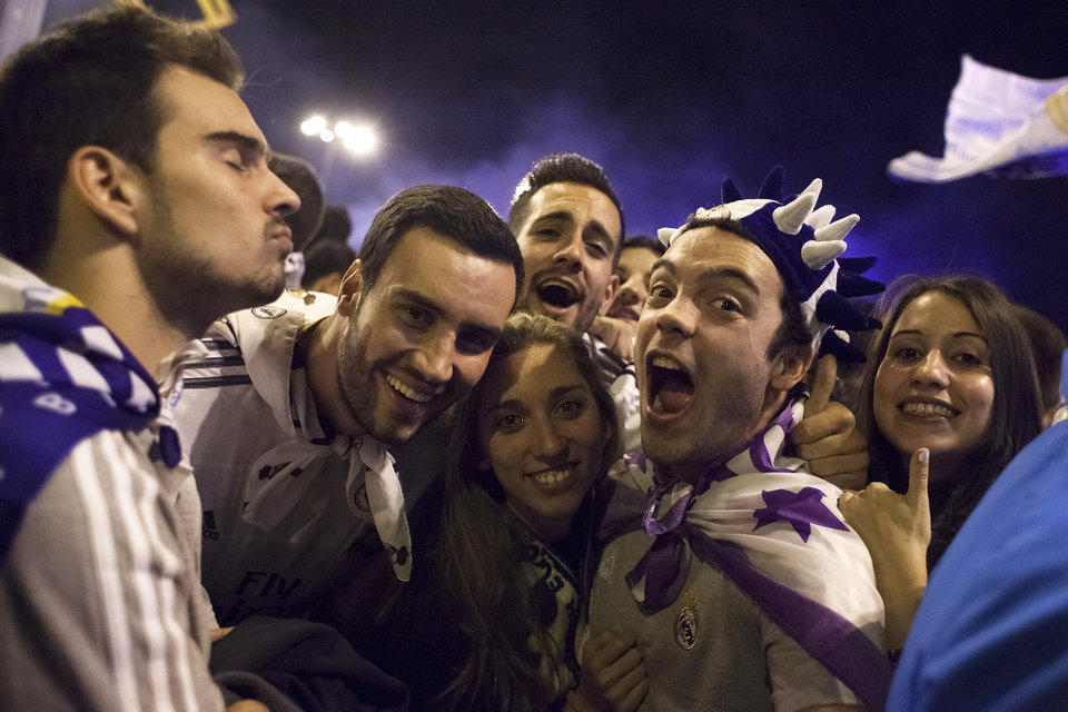 Photo - Real Madrid fans celebrate after their team won the Champions League final soccer match, taking place in Portugal, in Madrid, Spain, Saturday, May 24, 2014. (AP Photo/Gabriel Pecot)