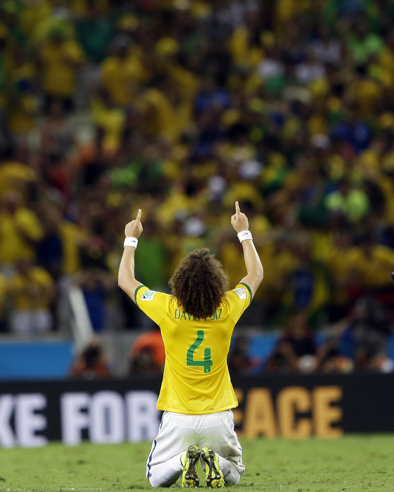 Photo - Brazil's David Luiz celebrates after Brazil's 2-1 victory to advance to the semifinals during the World Cup quarterfinal soccer match between Brazil and Colombia at the Arena Castelao in Fortaleza, Brazil, Friday, July 4, 2014. Luiz scored his side's second and decisive goal. (AP Photo/Andre Penner)
