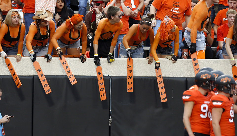 Oklahoma State students beat their  paddles against a wall prior to a college football game between Oklahoma State University (OSU) and the University of Texas (UT) at Boone Pickens Stadium in Stillwater, Okla., Saturday, Sept. 29, 2012. Photo by Bryan Terry, The Oklahoman