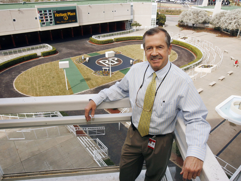 Photo - Remington Park President and General Manager Scott Wells stands on a balcony above the paddock area at Remongton Park racetrack in Oklahoma City, OK, Friday, March 6, 2009. BY PAUL HELLSTERN, THE OKLAHOMAN ORG XMIT: KOD