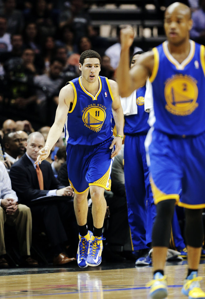 Photo - Golden State Warriors' Klay Thompson (11) and Jarrett Jack (2) react after scoring against the San Antonio Spurs during the first half of Game 2 in their Western Conference semifinal NBA basketball playoff series, Wednesday, May 8, 2013, in San Antonio. (AP Photo/Eric Gay)