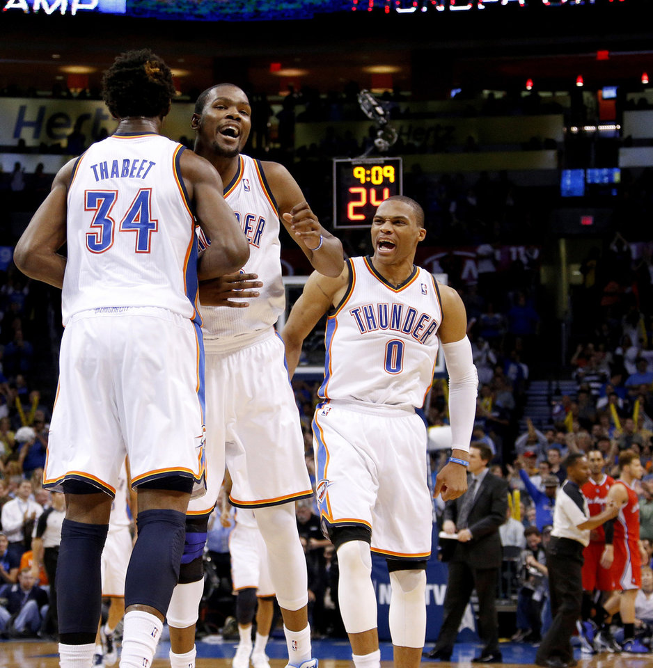Oklahoma City\'s Hasheem Thabeet (34), Kevin Durant (35), and Russell Westbrook (0) react during an NBA basketball game between the Oklahoma City Thunder and the Los Angeles Clippers at Chesapeake Energy Arena in Oklahoma City, Wednesday, Nov. 21, 2012. Photo by Bryan Terry, The Oklahoman
