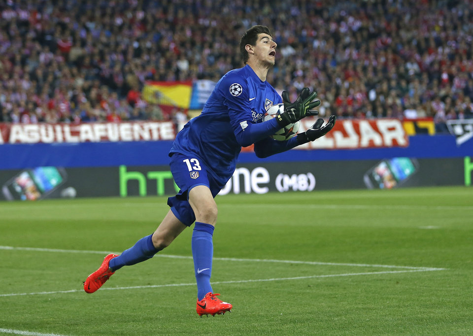 Photo - Atletico goalkeeper Thibaut Courtois catches the ball during the Champions League semifinal first leg soccer match between Atletico Madrid and Chelsea at the Vicente Calderon stadium in Madrid, Spain, Tuesday, April 22, 2014. (AP Photo/Andres Kudacki)