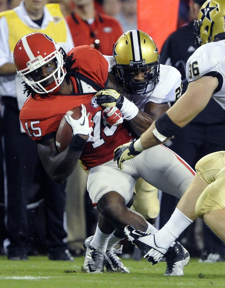Photo -   Georgia wide receiver Marlon Brown (15) is brought down by Vanderbilt defensive back Andre Hal during the first quarter of an NCAA college football game on Saturday, Sept. 22, 2012, in Athens, Ga. (AP photo/John Amis)