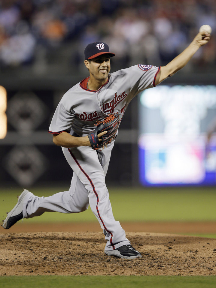 Photo - Washington Nationals' Gio Gonzalez pitches during the third inning of a baseball game against the Philadelphia Phillies, Tuesday, Sept. 3, 2013, in Philadelphia. (AP Photo/Matt Slocum)