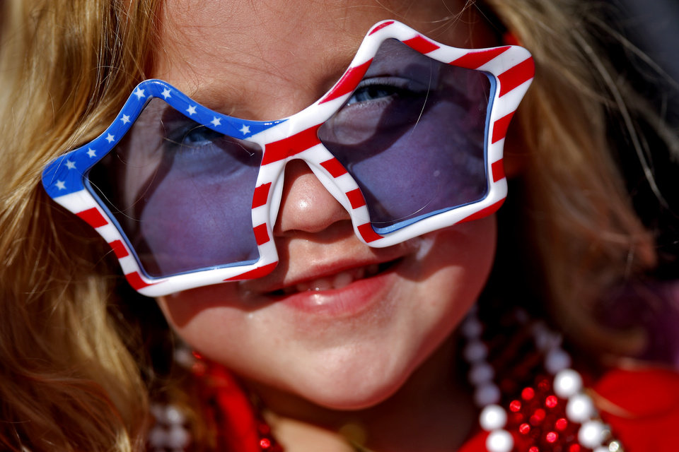 Photo - Caroline Hodges, 5, of Edmond watches the LibertyFest Fourth of July Parade in Edmond, Okla., Wednesday, July 4, 2012. Photo by Bryan Terry, The Oklahoman