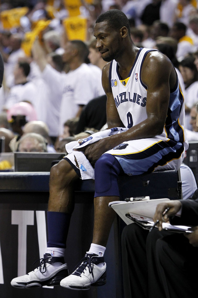 Memphis Grizzlies guard Tony Allen sits on the scorers\' table during the final moments of the third overtime of Game 4 against the Oklahoma City Thunder in a second-round NBA basketball playoff series on Tuesday, May 10, 2011, in Memphis, Tenn. Oklahoma City won 133-123 in triple overtime. (AP Photo/Wade Payne)