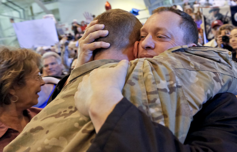 John Farrow hugs his son Jake to welcome him home during the return ceremony for more than 200 National Guard 45th Infantry Brigade Combat Team troops at the National Guard Base on Monday, March 12, 2012, in Oklahoma City, Oklahoma.  Photo by Chris Landsberger, The Oklahoman