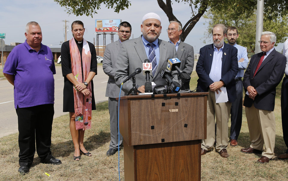 Photo - Imad Enchassi, imam of the Islamic Society of Greater Oklahoma City, speaks Wednesday during a news conference called by the Oklahoma chapter of the Council on American-Islamic Relations in front of Republican Party headquarters in response to Rep. John Bennett's statements about Muslims.  Photos by Doug Hoke,  The Oklahoman  DOUG HOKE - THE OKLAHOMAN