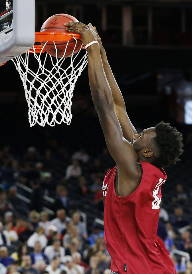 Photo - Oklahoma's Khadeem Lattin (12) dunks during practice on Final Four Friday before the national semifinal between the Oklahoma Sooners and the Villanova Wildcats in the NCAA Men's Basketball Championship at NRG Stadium in Houston, Friday, April 1, 2016. OU will play Villanova in the Final Four on Saturday. Photo by Nate Billings, The Oklahoman