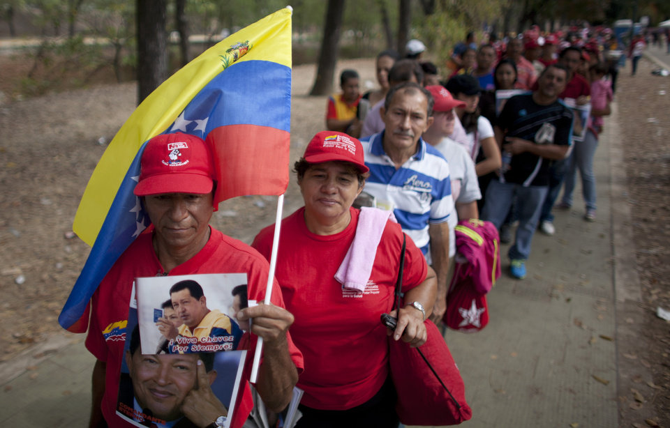 Photo - People queue outside the military academy where Venezuela's late President Hugo Chavez is lying in state in Caracas, Venezuela, Sunday, March 10, 2013. Chavez died on March 5 after a nearly two-year bout with cancer. He was 58. (AP Photo/Ariana Cubillos)