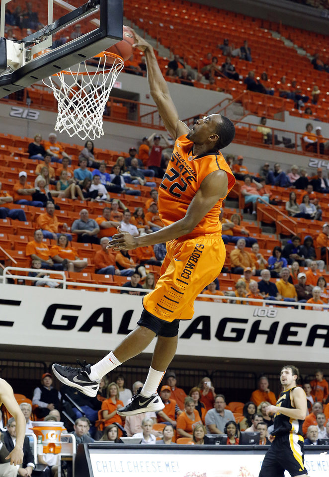 Photo - Oklahoma State's Markel Brown dunks the college basketball game between Oklahoma State University and Ottawa (Kan.) at Gallagher-Iba Arena in Stillwater, Okla., Thursday, Nov. 1, 2012. Photo by Sarah Phipps, The Oklahoman (AP Photo/The Oklahoman, Sarah Phipps)