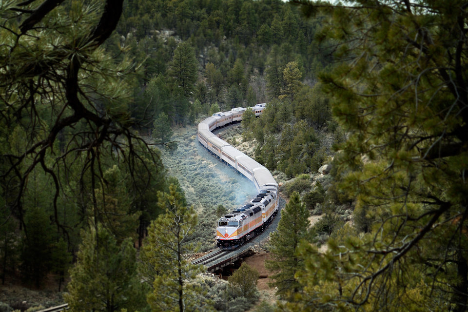 Photo - This photo provided by Grand Canyon Railway shows the train on its daily run between Williams, Arizona, and the Grand Canyon's South Rim. The railway has been running since 1901, carries 225,000 people a year and offers history, sightseeing, scenery and entertainment. (AP Photo/Grand Canyon Railway)