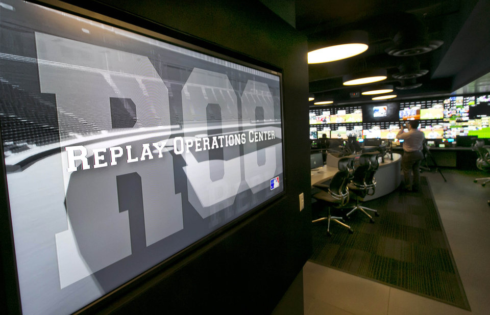 Photo - Banks of television screens line the walls of Major League Baseball's Replay Operations Center during a preview of the venue, in New York, Wednesday, March 26, 2014. Less than a week before most teams open, MLB is working on the unveiling of its new instant replay system, which it hopes will vastly reduce incorrect calls by umpires. (AP Photo/Richard Drew)