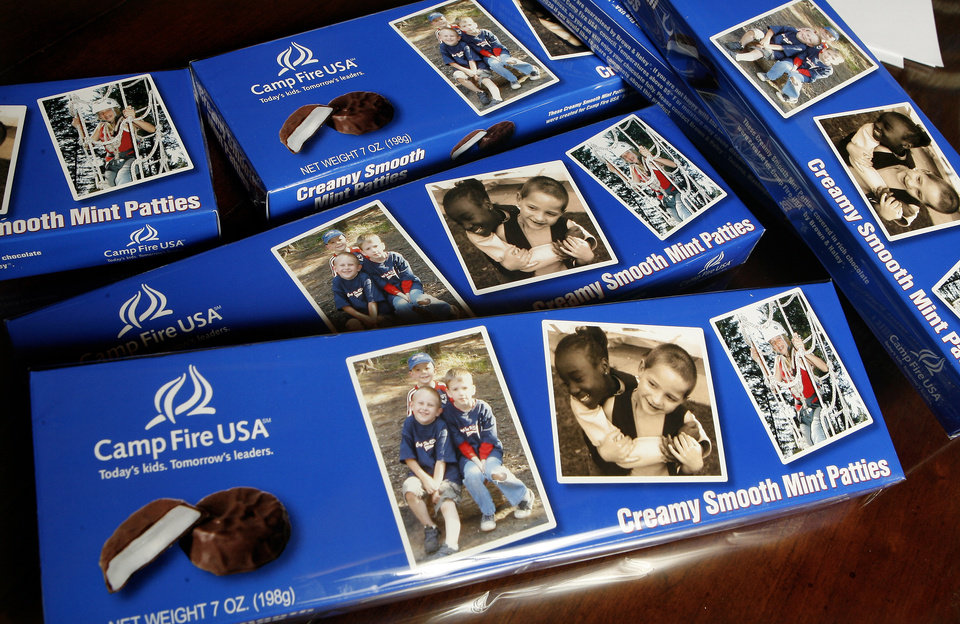 Photo - Boxes of Camp Fire USA mint patty candy with a photo on the front, left photo, of Hayden Hirzel, 5, left, Landen Hirzel, 3, center, Adam Deter, 6, right, in Guthrie Wednesday, Jan. 2, 2008. BY PAUL B. SOUTHERLAND, THE OKLAHOMAN