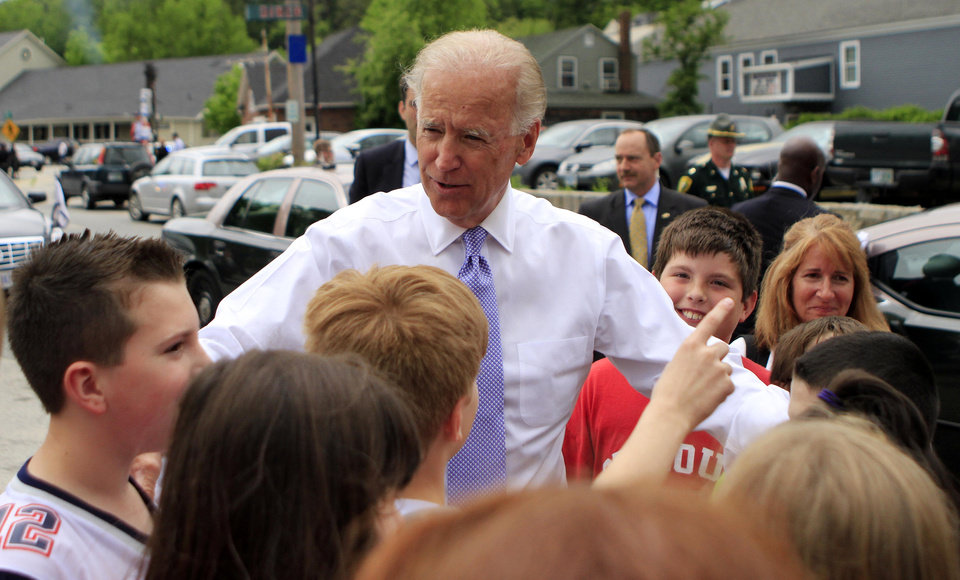 Photo - Vice President Joe Biden greets a group of students during a campaign lunch stop at the diner in Peterborough, N.H., Tuesday, May 22, 2012.  (AP Photo/Jim Cole)